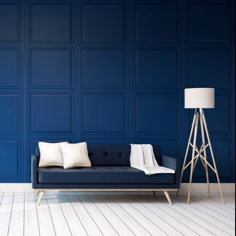Sofa With Floor Lamp By Blue Wall At Home