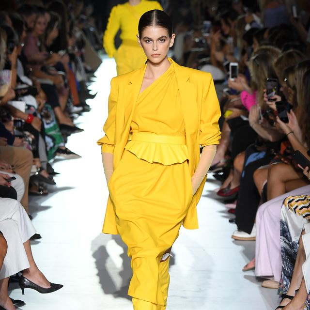 Fashion model, Fashion, Runway, Fashion show, Yellow, Fashion design, Shoulder, Event, Public event, Human,