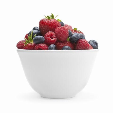 A small white bowl of soft fruit.