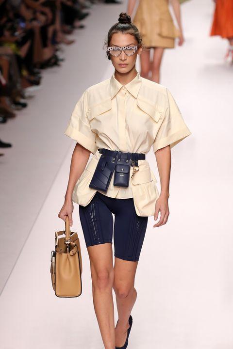 Fashion model, Fashion show, Fashion, Clothing, Shoulder, White, Runway, Sandal, Shorts, Footwear,