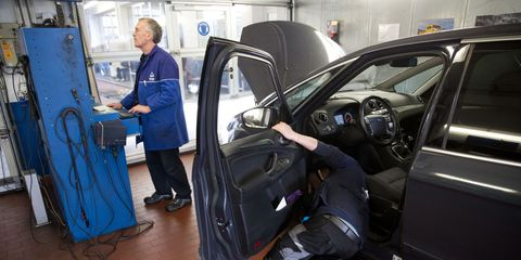a staff member of tuv, the technical inspection association for cars and consumer products, insepects a car at the tuv testing and service station in berlin, germany, 4 november 2014 photo joerg carstensendpa  usage worldwide   photo by jörg carstensenpicture alliance via getty images