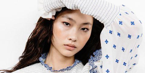 White, Hair, Face, Clothing, Beauty, Head, Lip, Skin, Knit cap, Forehead,