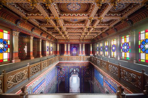 Stained glass, Building, Architecture, Interior design, Glass, Ceiling, Room, Lobby, Symmetry, Window,