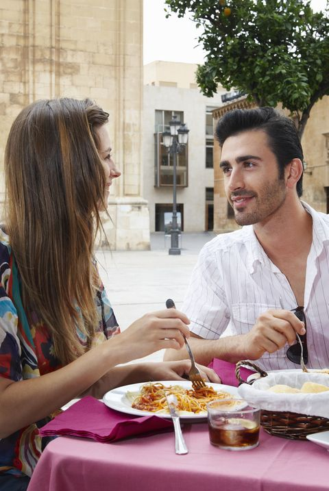 Couple in pavement cafe