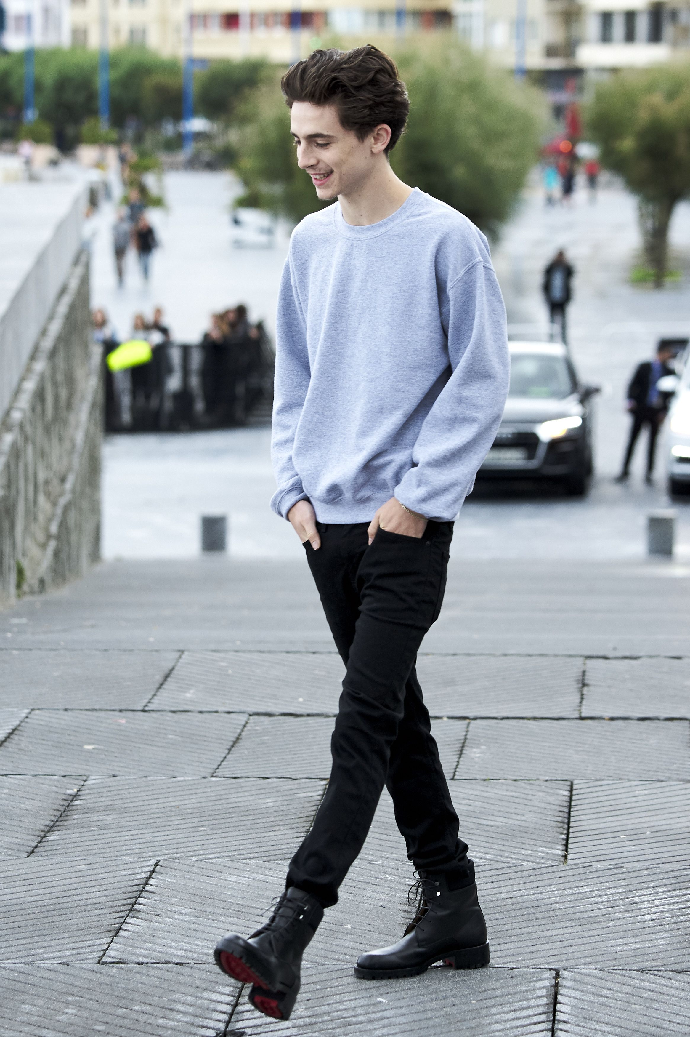 Timothée Chalamet A gray crewneck sweatshirt doesn't have to look like a sick-day outfit unless you let it. Pairing it with denim and lace-up boots make it feel purposeful.