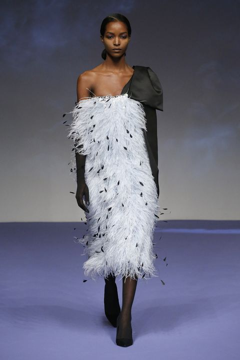 Fashion model, Fashion, White, Fashion show, Clothing, Shoulder, Runway, Fashion design, Haute couture, Beauty,