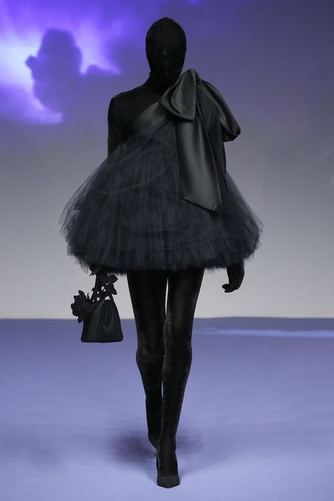 Fashion, Purple, Violet, Shoulder, Haute couture, Fashion design, Dress, Fashion model, Joint, Footwear,