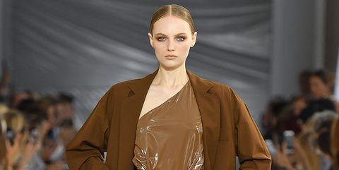 Fashion model, Fashion show, Fashion, Runway, Clothing, Brown, Fashion design, Outerwear, Human, Public event,