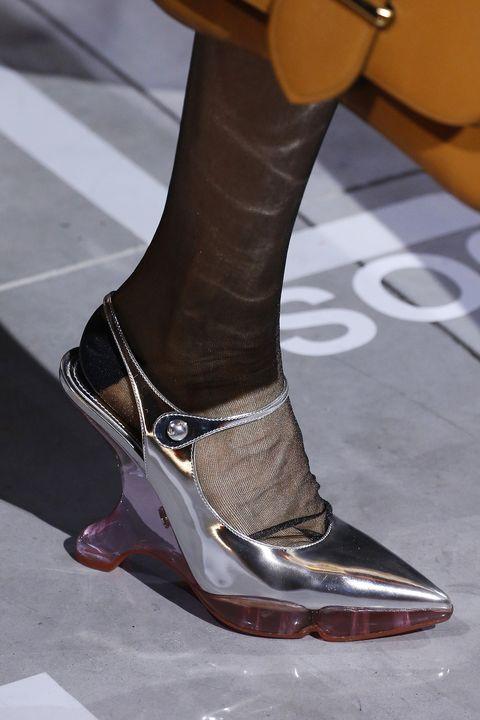 Footwear, Shoe, Fashion, Leg, Ankle, Human leg, Joint, Brown, High heels, Haute couture,