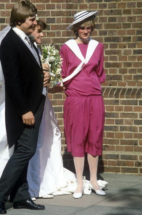 Clothing, Pink, Suit, Fashion, Formal wear, Dress, Outerwear, Headgear, Hat, Event,