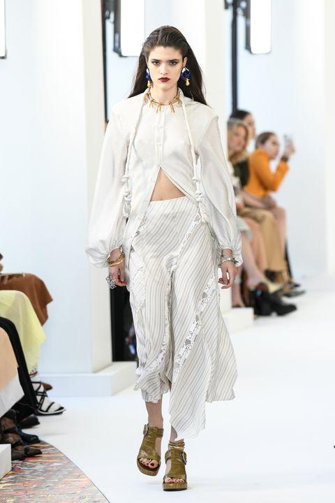 Fashion model, Fashion show, Fashion, Runway, Clothing, White, Shoulder, Haute couture, Outerwear, Fashion design,