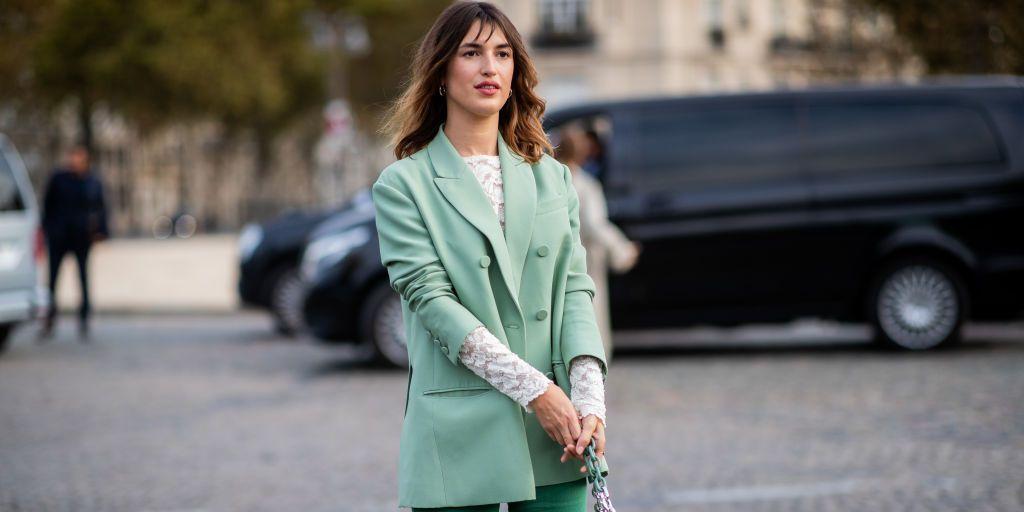 Jeanne Damas wearing green blazer, flared pants is seen outside Valentino during Paris Fashion Week Womenswear Spring/Summer 2019 on September 30, 2018 in Paris