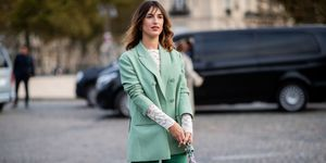 Jeanne Damas wearing green blazer, flared pants is seen outside Valentino during Paris Fashion Week Womenswear Spring/Summer 2019 on September 30, 2018 in Paris