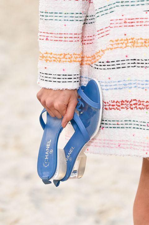 Footwear, Blue, Human leg, Leg, Ankle, Shoe, Electric blue, Orange, Joint, Foot,