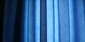 Full Frame Shot Of Blue Curtain At Home