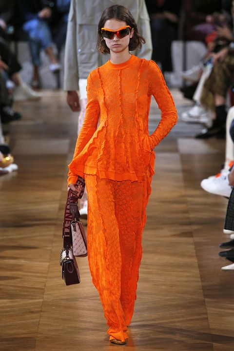 Fashion model, Fashion, Fashion show, Runway, Orange, Clothing, Haute couture, Event, Fashion design, Street fashion,