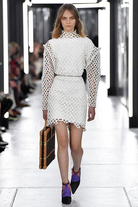 Fashion model, Fashion, Fashion show, Runway, White, Clothing, Shoulder, Haute couture, Street fashion, Waist,