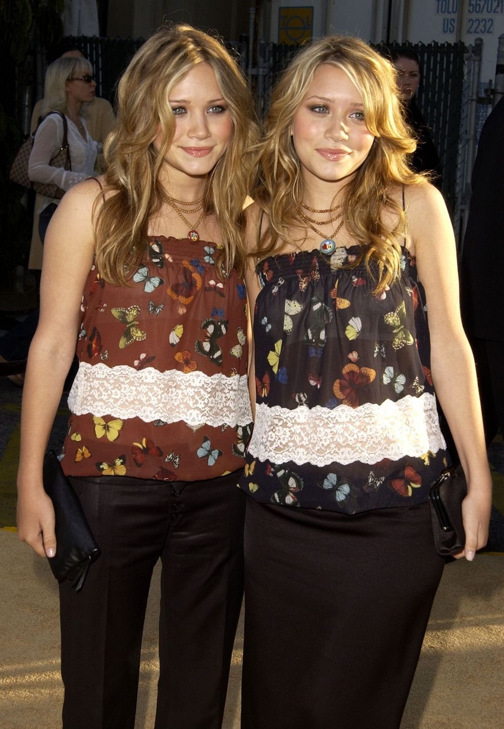 July 22, 2002 For the premiere of Austin Powers in Goldmember, the twins wore matching butterfly printed camisoles and black pants.