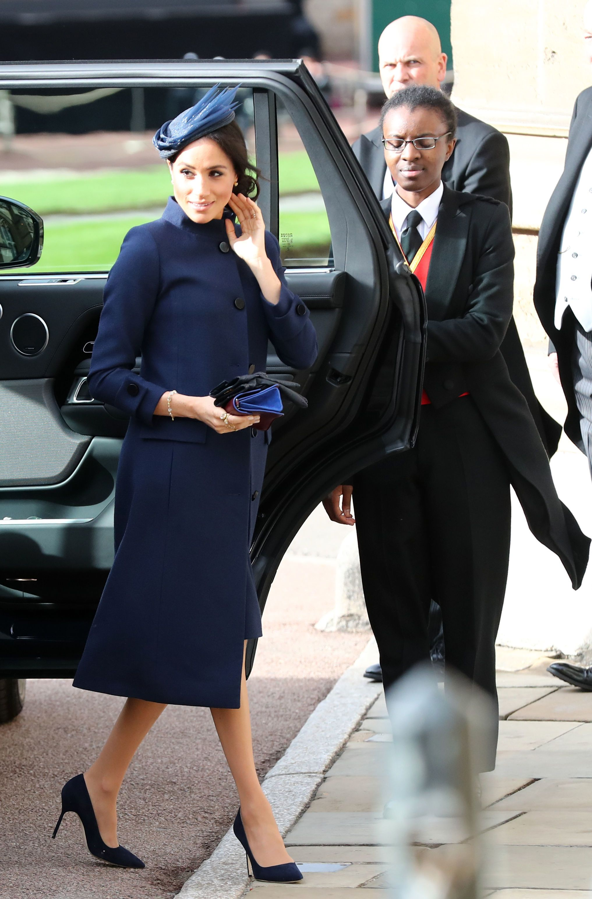 1b74caa6f037 Meghan Markle Wears a Navy Givenchy Dress To Princess Eugenie and Jack  Brooksbank s Wedding