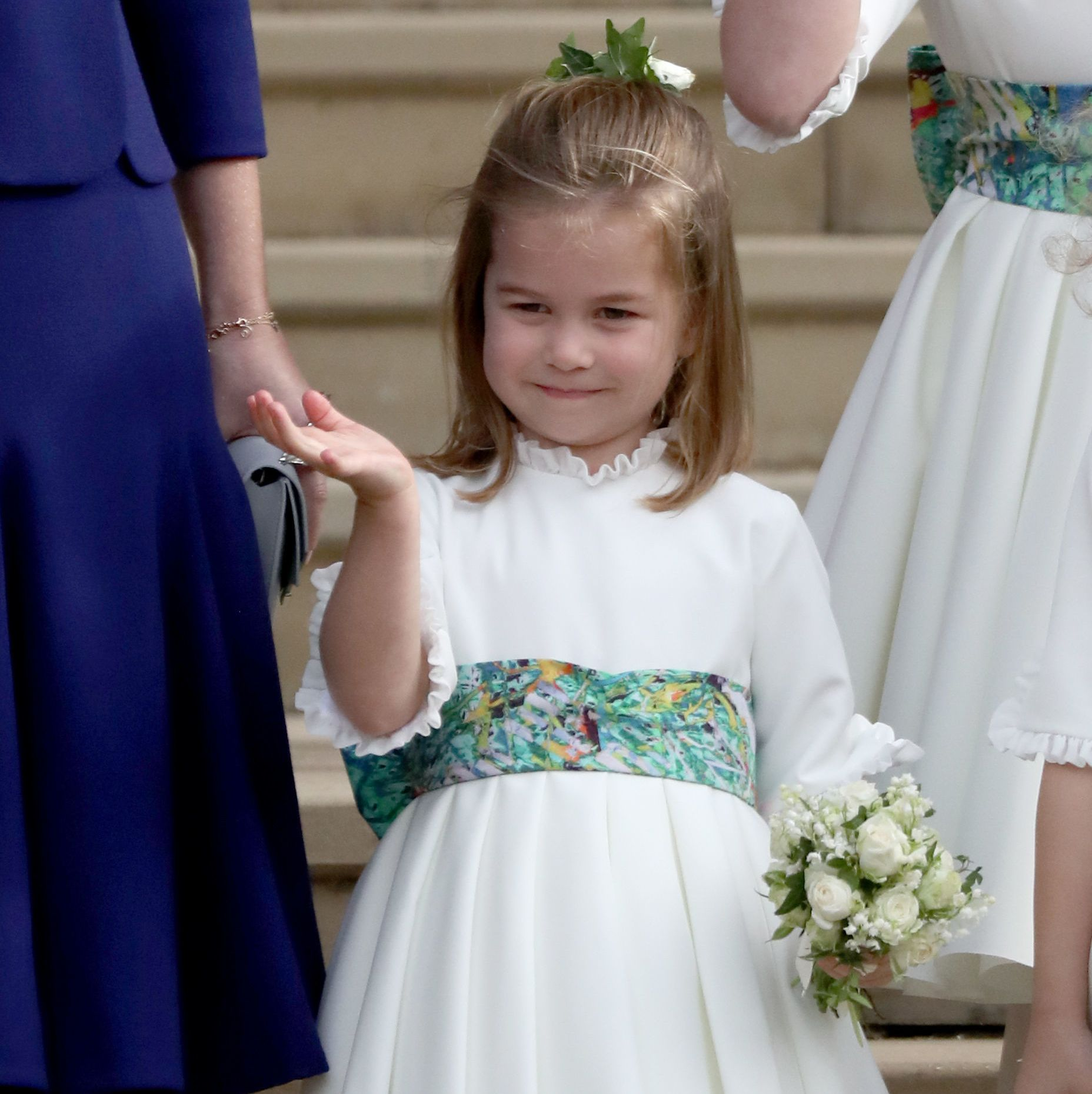 Here she is, waving on another set of steps at Princess Eugenie's royal wedding last fall.