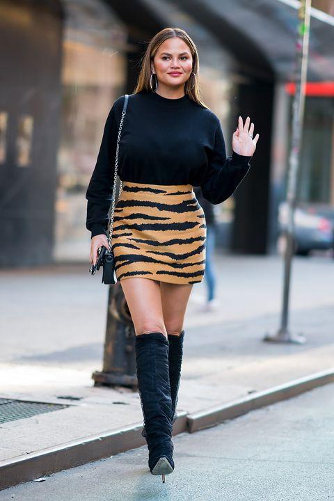 Clothing, Street fashion, Black, Shoulder, Fashion, Fashion model, Joint, Knee-high boot, Knee, Footwear,