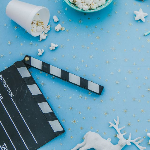 movie tickets, clapperboard, pop corn and 3d glasses in a red frame backgroundflat lay christmas concept