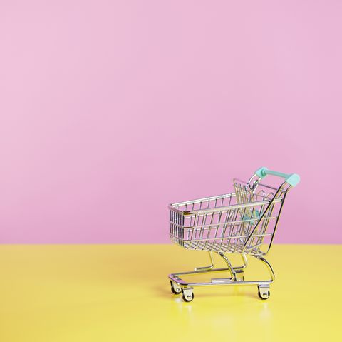 toy shopping trolley with pink  and yellow background