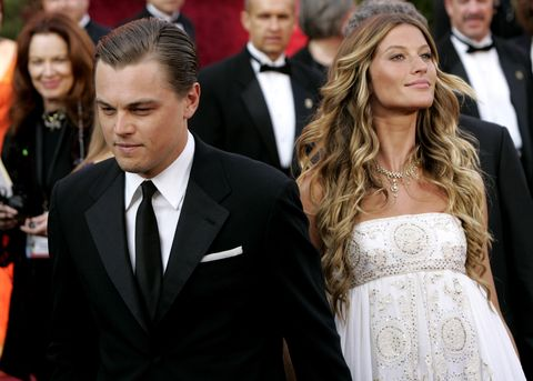 Hair, Facial expression, Suit, Hairstyle, Event, Formal wear, Premiere, Fashion, Carpet, Dress,