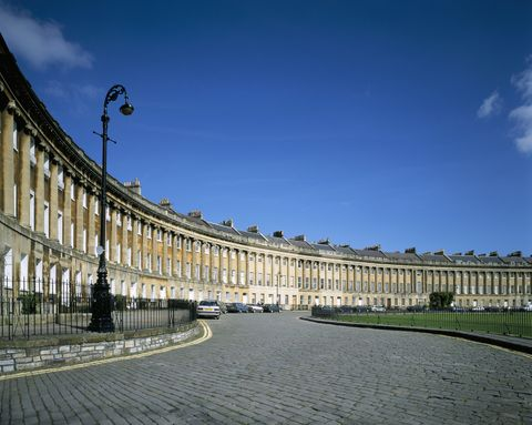 the royal crescent was built between 1767  1775, and was designed by john wood the younger it is a row of houses and they are grade i listed buildings