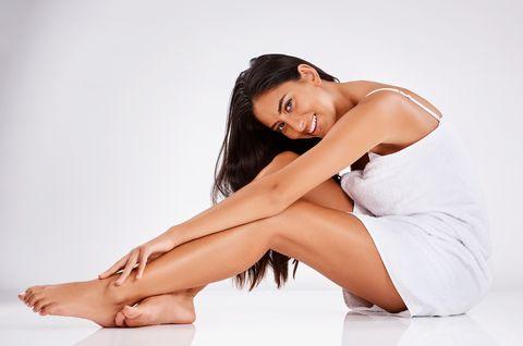 White, Skin, Human leg, Leg, Beauty, Sitting, Thigh, Nose, Model, Black hair,