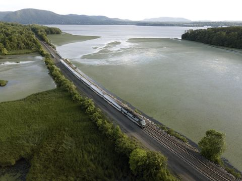 Passenger train traveling up the hudson river