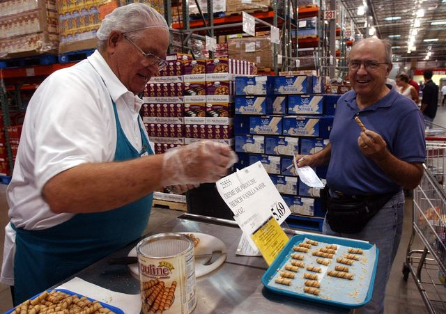 vaughn fish cq left, offers sample of  food  to buz smith saturday at costco this is a slice on the costco culturephoto by cliff grassmickdigital first mediaboulder daily camera via getty images
