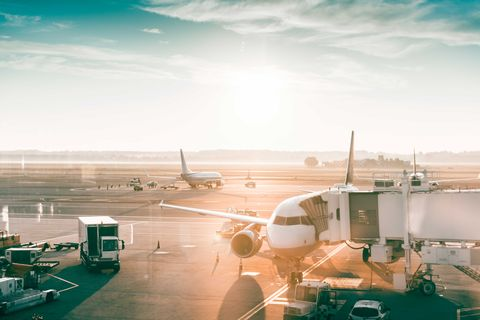 Airplanes in an airport at sunrise