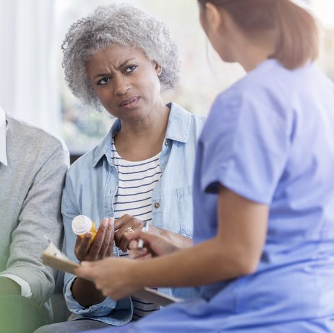 Senior woman questions doctor about drug side effects