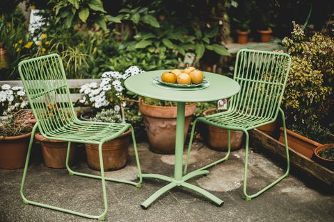 green garden furniture in a small garden.