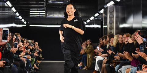 Runway, Fashion, Event, Fashion show, Audience, Fashion design, Footwear, Crowd, Fashion model, Model,