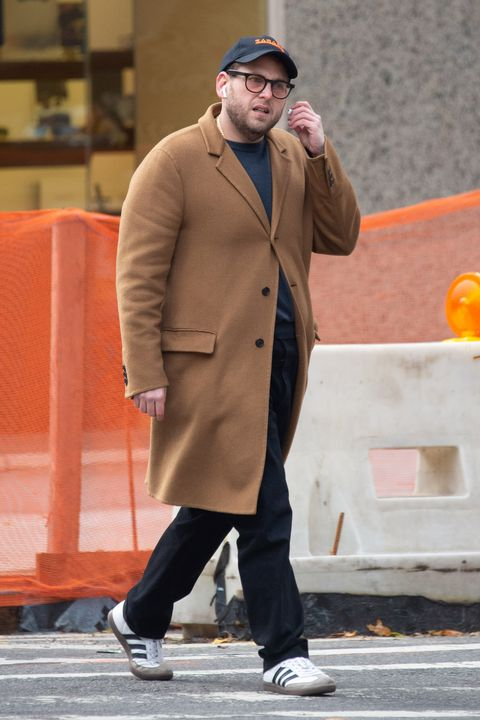 Street fashion, Fashion, Overcoat, Standing, Human, Coat, Outerwear, Sunglasses, Headgear, Beard,