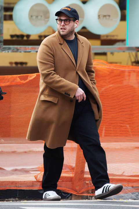 Fashion, Orange, Human, Performance, Suit, Outerwear, Formal wear, Hat, Performing arts, Style,