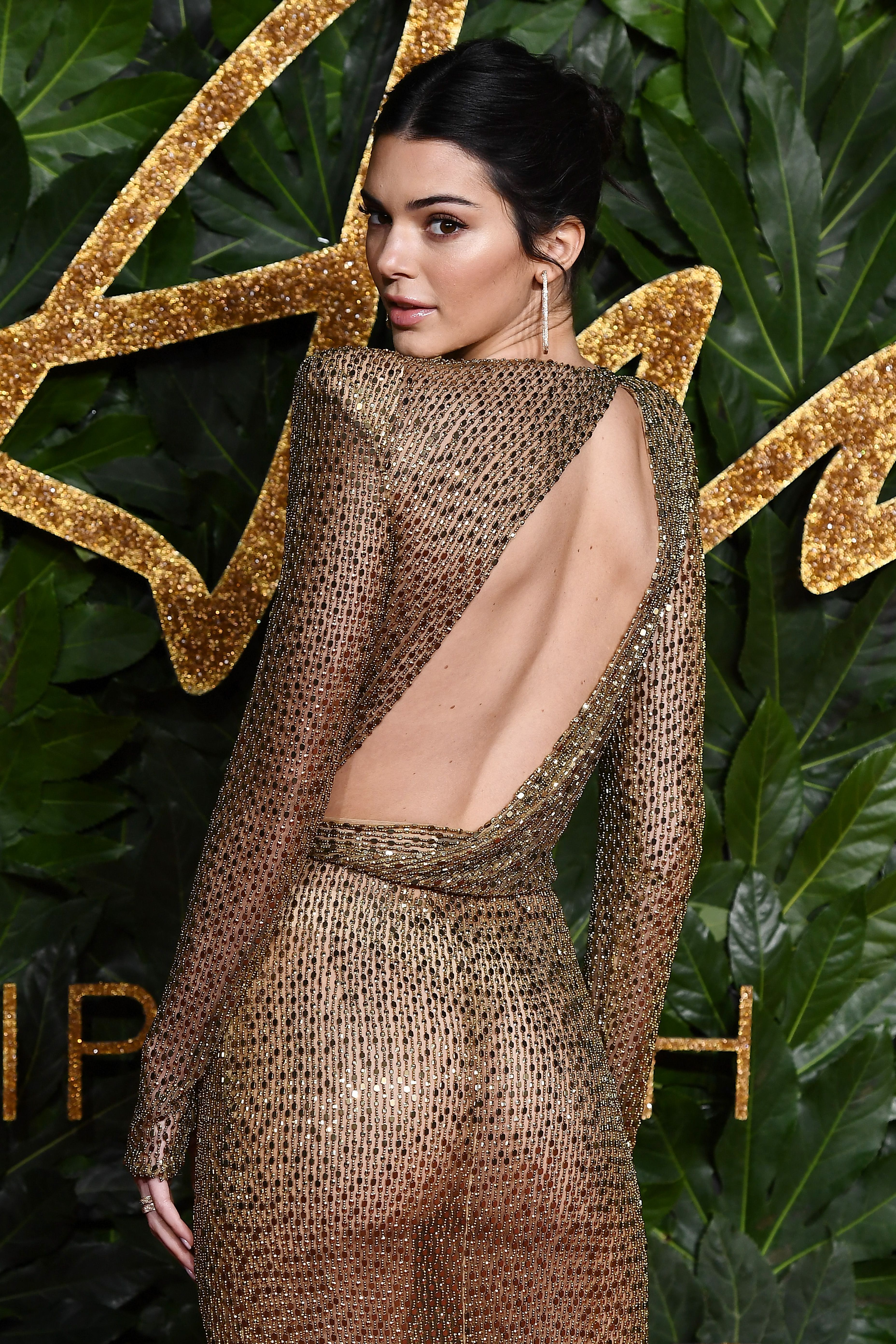 3c828422 Kendall Jenner Wears a Gold Naked Dress to The Fashion Awards in London