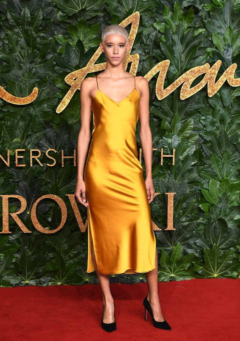 Red carpet, Carpet, Clothing, Dress, Yellow, Flooring, Fashion, Fashion model, Shoulder, Cocktail dress,