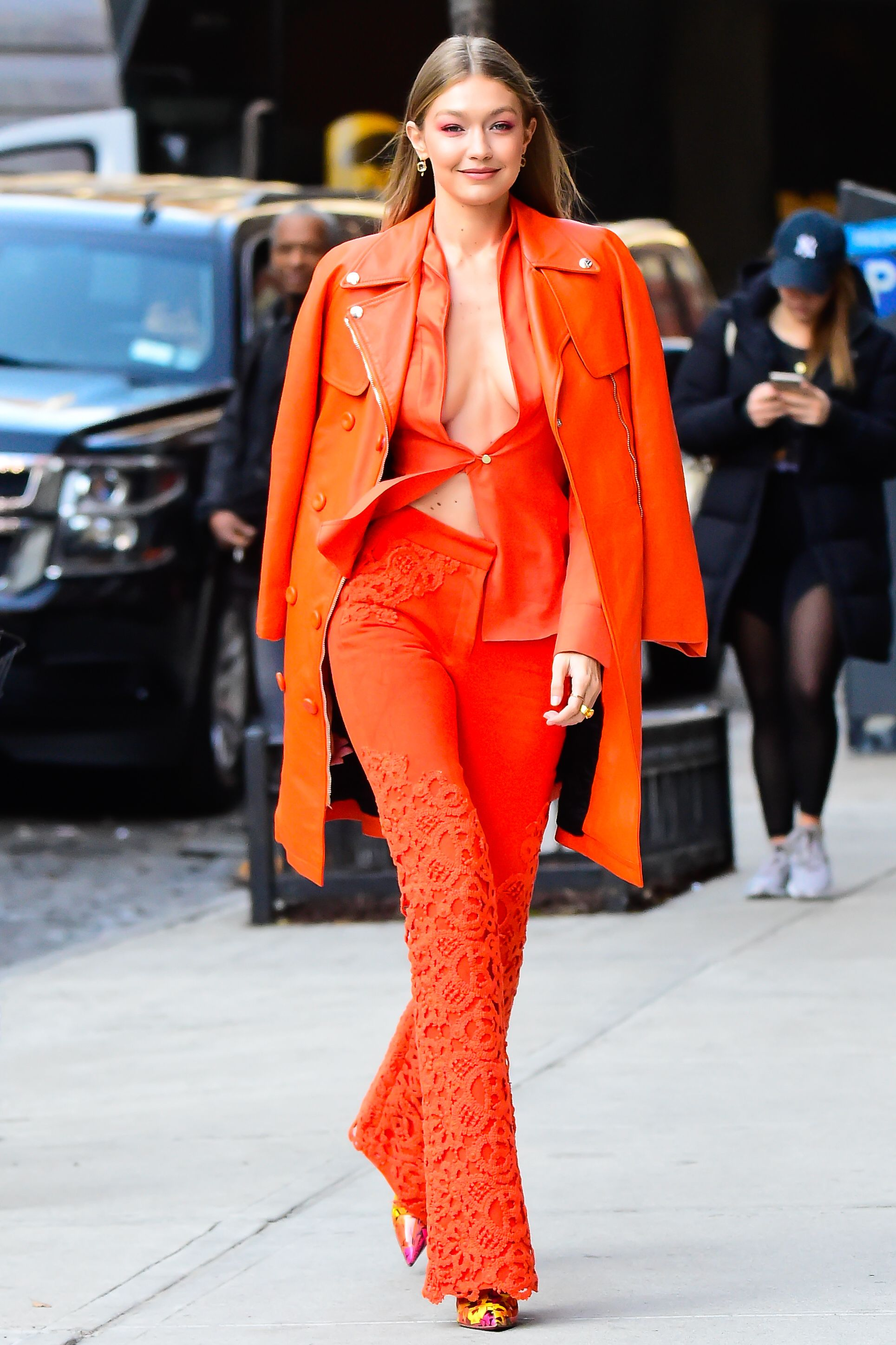 December 11, 2018 Braving the cold, Gigi wore a monochromatic orange ensemble while heading out to visit the IMG Models offices in New York City. Despite the freezing temperatures, the star wore a shirt held together with only one button, which flapped in the wind.