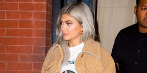 Kylie jenner in lambskin jacket and red trousers