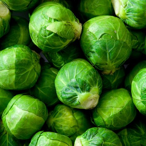 A dish full of uncooked, unpeeled sprouts