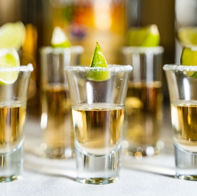 Glasses of alcohol and lime on the restaurant table.