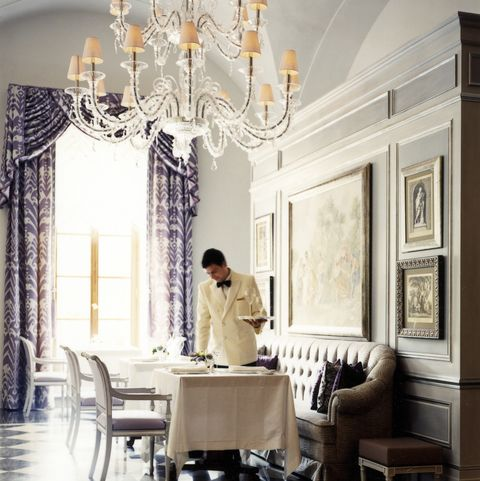 waiter setting table in an elegant restaurant at the four seasons florence