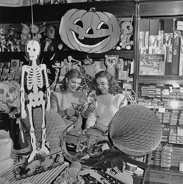 two young women examine a paper skeleton amongst other items in a novelty store selling decorations and other items for halloween in the 1940s photo by archive photosgetty images