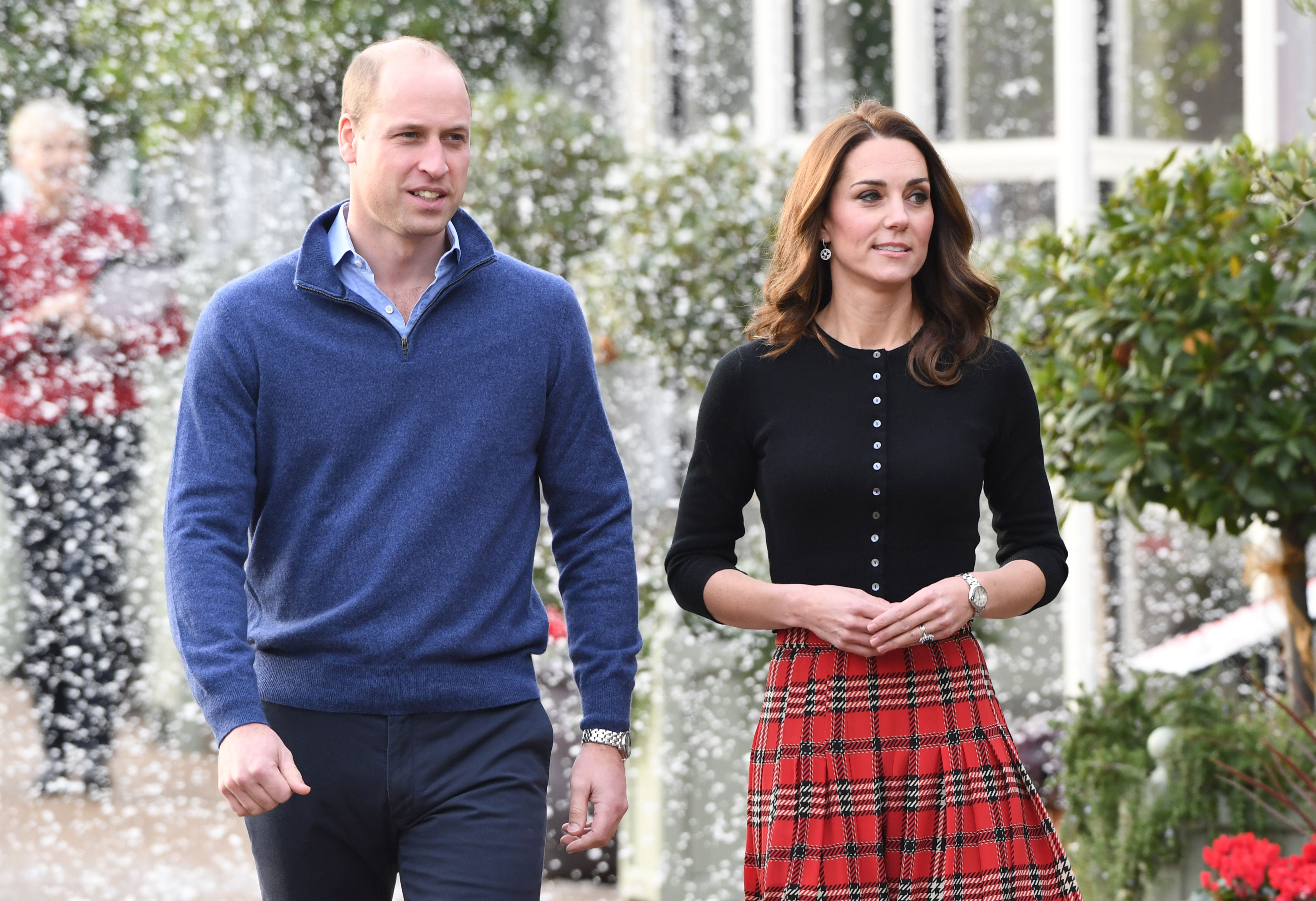 3b382af63 Kate Middleton Wears Black Top and Red Plaid Skirt for Her and Prince  William's RAF Family Christmas Party