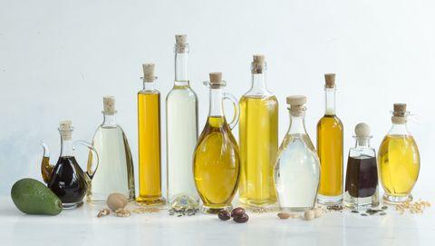 Glass bottle, Bottle, Liqueur, Product, Yellow, Wine bottle, Drink, Alcohol, Cooking oil, Olive oil,