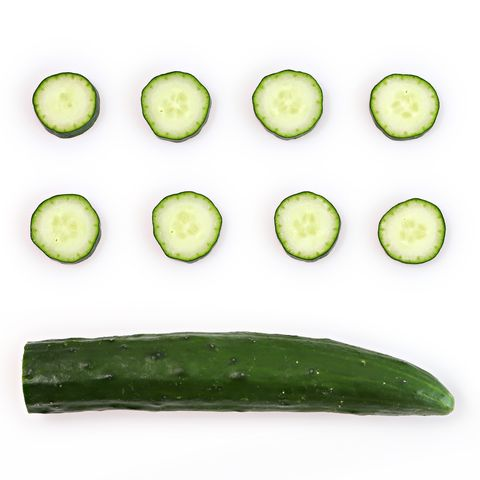 Directly Above Shot Of Zucchinis On White Background