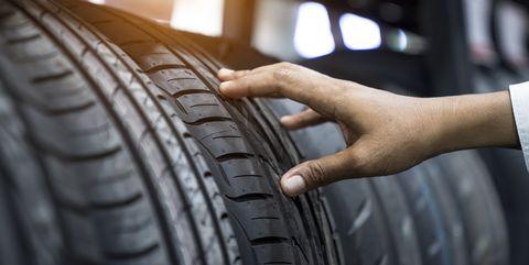 Hand finger checking tire